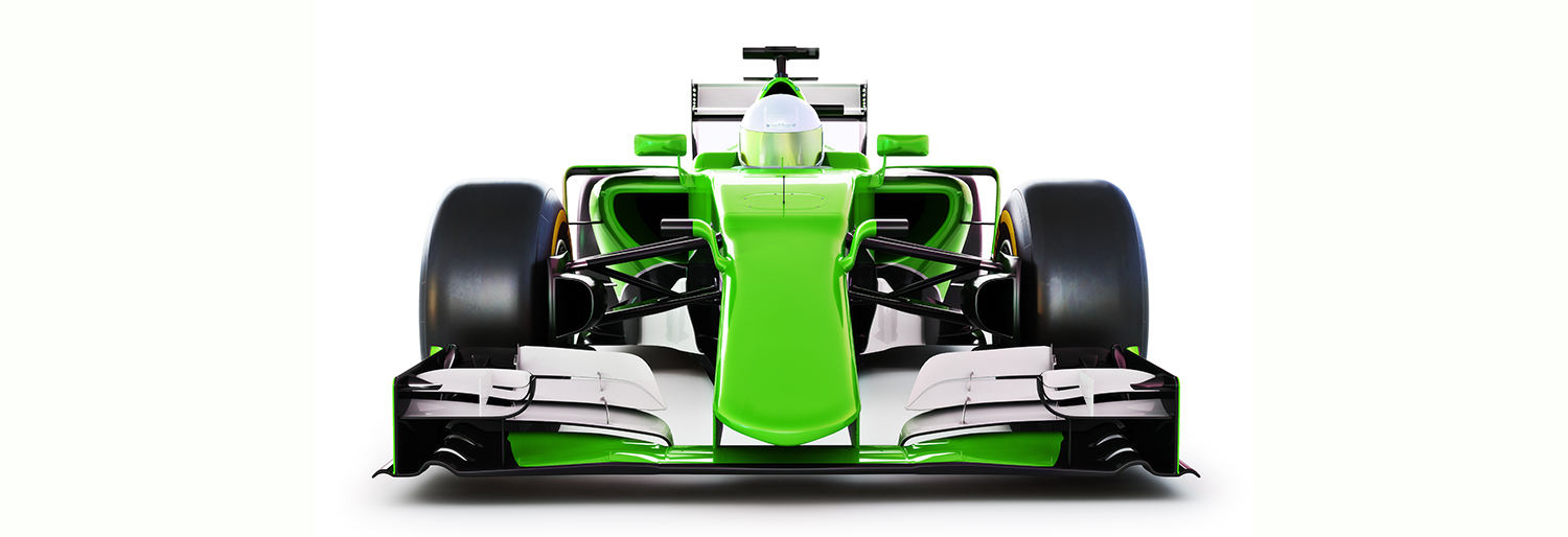 Front view of a green race car and driver on a white isolated ba